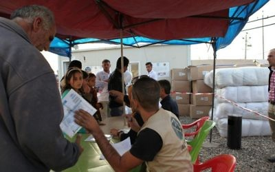 Distribution of bedding at Erbil refugee camp in Kurdistan