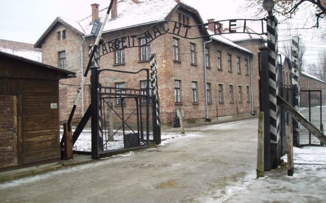 Auschwitz, a former Nazi death camp located in modern day Poland, with its infamous gate - 'Arbeit Macht Frei' - works makes you free - above the entrance
