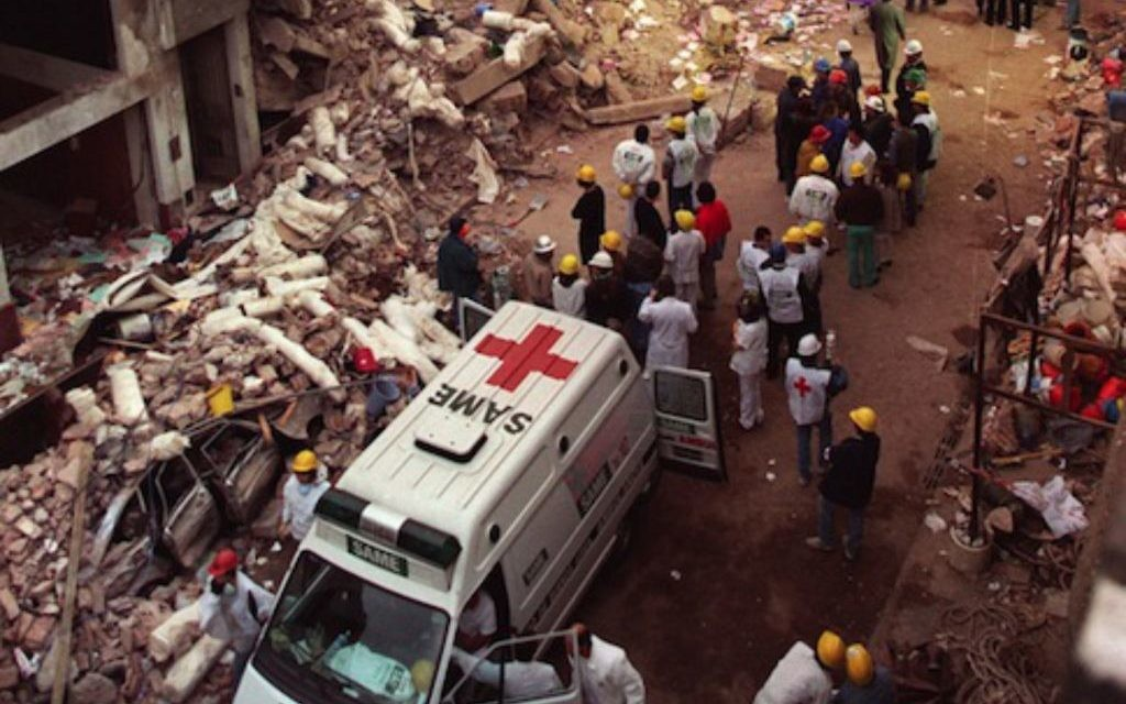 Firefighters and rescue workers search through the rubble of the Buenos Aires Jewish Community centre in  July 1994.