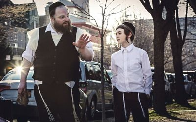 Menashe Lustig plays Menashe, with his on-screen son Rieven, portrayed by Ruben Niborski
