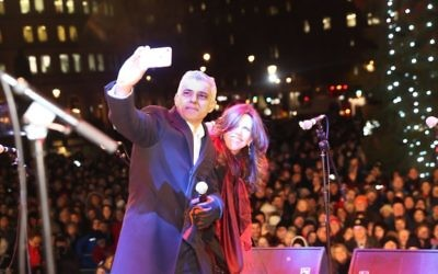 London Mayor Sadiq Khan takes a selfie at Chanukah in the Square   Credit: Marc Morris Photography