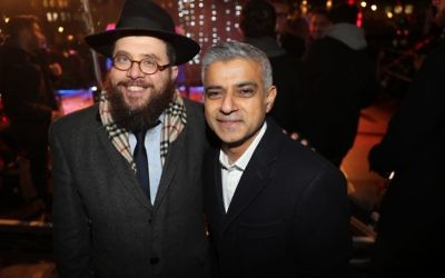 Chanukah in the Square: London Mayor Sadiq Khan (right) with a Chabad rabbi   Credit: Marc Morris Photography