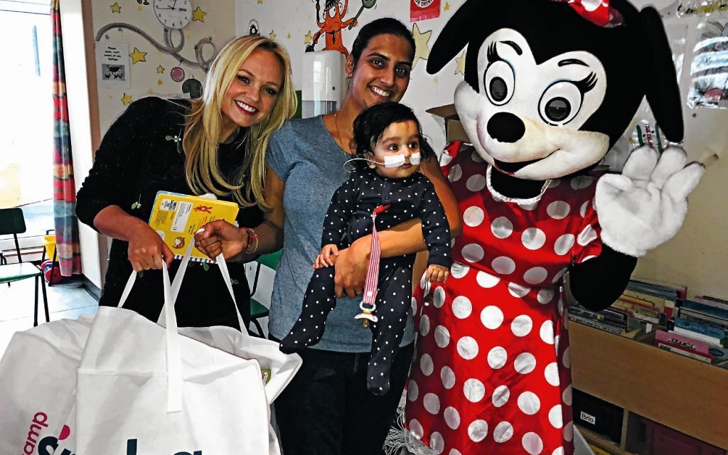 Emma Bunton and Minnie Mouse meet a young patient during a Camp Simcha event