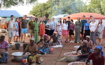 Ben Azzai group and Rabbi Daniel Epstein with Shea Butter co-op found Joanna (in green dress) at women's co-op in Tamale, northern Ghana