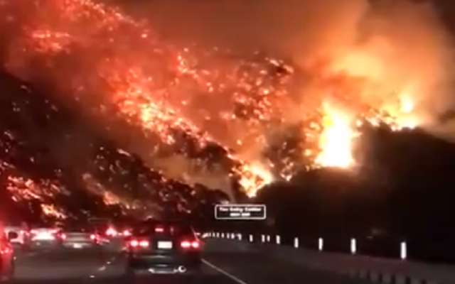 Flames ravaged through southern california   Credit: Scott Dworkin's video on Twitter (@funder)