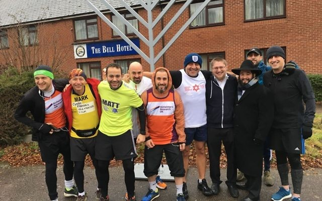 The dads at the start of the half-marathon in front of the Epping menorah