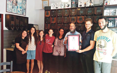 Staff at the Coffee Mill cafe Jerusalem with Rabbi Aaron Leibowitz
