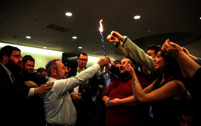 Young and old celebrate havdallah at the end of Shabbat during Limmud FSU in the city of St Petersburg  Photo by Masha Lvova