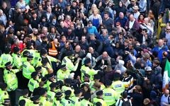 Police stopping anti-fascist protesters from clashing with far-right National Action members   Photo credit: Peter Byrne/PA Wire