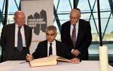 Holocaust survivors Sir Ben Helfgott and Manfred Goldberg  besides Mayor of London Sadiq Khan, as he signs the Holocaust Educational Trust (UK) Book of Commitment at City Hall. 2018