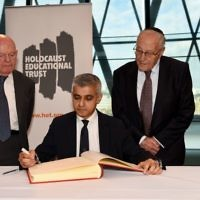 Holocaust survivors Sir Ben Helfgott and Manfred Goldberg  besides Mayor of London​ Sadiq Khan​, as he signs the Holocaust Educational Trust (UK)​ Book of Commitment at City Hall. 2018