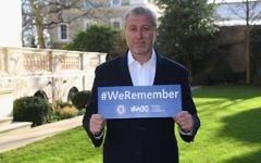 Chelsea owner Roman Abramovich with a 'We Remember' sign after International Holocaust Remembrance Day