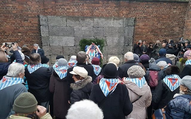 73rd anniversary of the liberation of Auschwitz: Survivors paying homage to all victims of the camp at the execution yard of the Auschwitz I camp  Credit: @AuschwitzMuseum