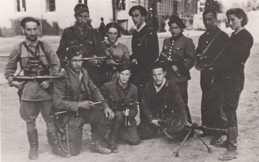 Abba Kovner stands at the centre of the Vilna Ghetto Fighters, some of whom later joined Nakam (The Avengers)