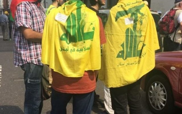 Hezbollah flags draped over teenagers at the Al Quds Day march 2017