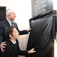 Prime Minister Benjamin Netanyahu with Moshe Holtzberg, son of the victims killed in the attack, at a memorial ceremony for the victims at the Chabad House in Mumbai. Photo: Avi Ohayon, GPO