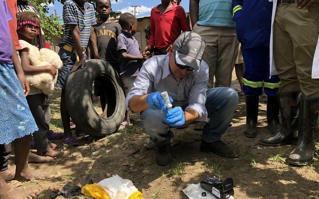 Professor Eli Schwartz, head of Sheba Medical Center's Tropical Diseases Department, testing the water quality