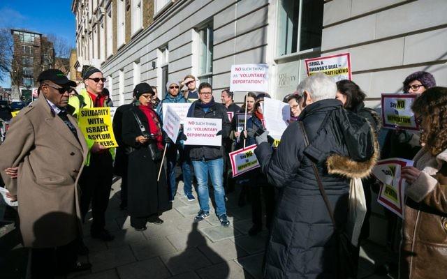 Demonstrators gather outside the Rwandan Embassy in London against Israel's contoversial deportation of African asylum seekers   Credit: Yakir Zur