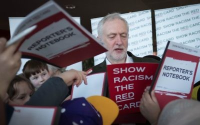 Labour leader Jeremy Corbyn joins school children at the Emirates Stadium in London where he spoke to the Show Racism the Red Card event to make children more aware of race issues and how to address them. Photo credit: Stefan Rousseau/PA Wire