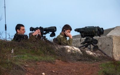 Members of the United Nations Disengagement Observer Force (UNDOF) looks through binoculars at Mount Bental, an observation post in the Israeli occupied Golan Heights near the ceasefire line between Israel and Syria February 9, 2018. Photo by: JINIPIX