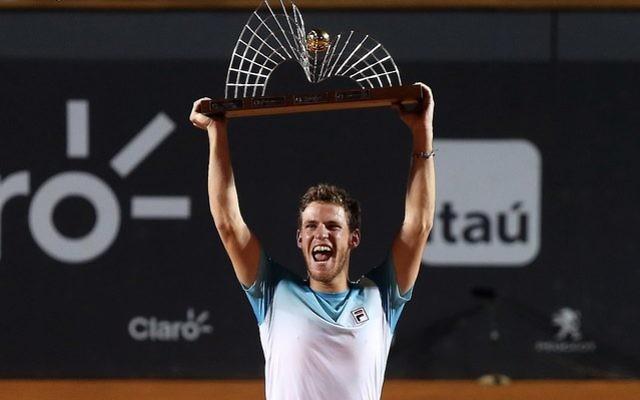 Diego Schwartzman celebrates winning the Rio Open
