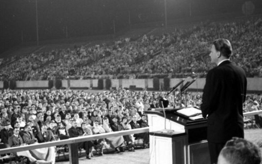Evangelist Billy Graham  speaking at Doak Campbell Stadium in Tallahassee, Florida
