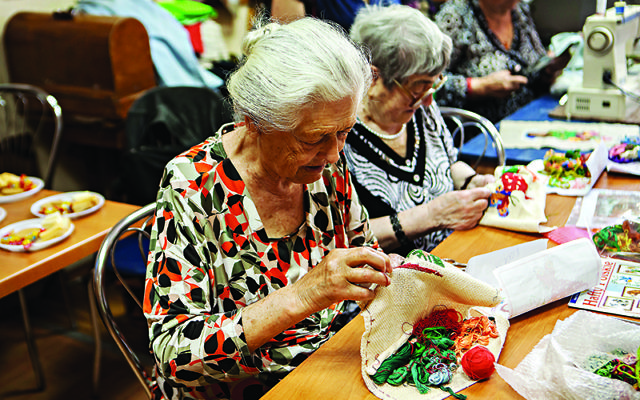 Elderly Jewish Ukrainian ladies practice traditional embroidery. Communities in Ukraine benefit from the charitable work of World Jewish Relief in alleviating poverty