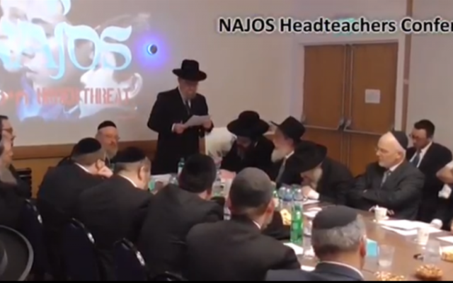 Screengrab from the video attacking allies of the community. Still shows the NAJOS headteachers conference