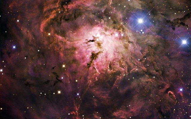 Gas and dust condense, beginning the process of creating new stars in this image of Messier 8, also known as the Lagoon Nebula.  Credit: ESO/IDA/Danish 1.5 m/ R. Gendler, U.G. Jørgensen, K. Harpsøe