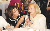 Natasha Kaplinsky listens to survivor Gena Turgel.