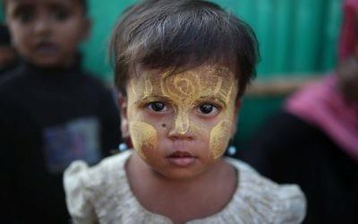A Rohingya refugee child looks on at Jamtoli camp in Cox's Bazar, Bangladesh