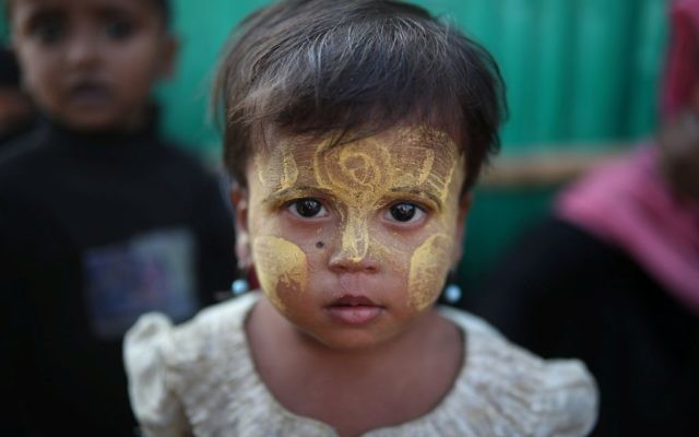 A Rohingya refugee child looks on at Jamtoli camp in Cox's Bazar, Bangladesh