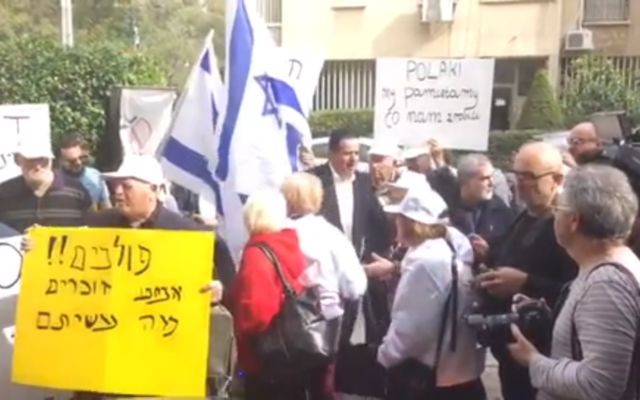 Survivors and activists protest outside the Polish Embassy in Tel Aviv.   Screenshot from a video on Jerusalem Post