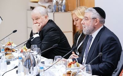 Rabbi Goldschmidt (right) speaks during a conference in February