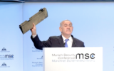 Benjamin Netanyahu holds a piece of Iranian drone that Israel shot down at the Munich security conference