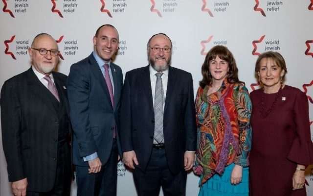 The World Jewish Relief Dinner included guests (from left): Henry Grunwald, Dan Rosenfield, Chief Rabbi Mirvis and his wife Valerie, and Linda Rosenblatt.