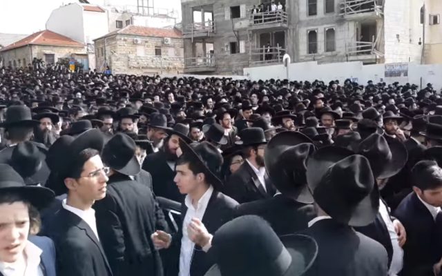 Screenshot from video of mourners at the funeral procession for Shmuel Auerbach,