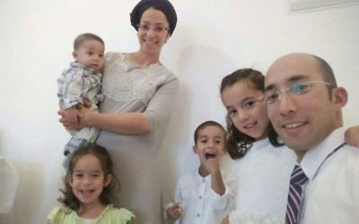 Itamar Ben Gal (right) with his wife and four young children.   Source: @NewsFlashIL on Twitter