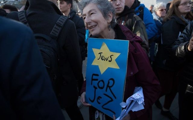 Jewish Jeremy Corbyn supporter Naomi Wimborne-Idrissi, of Jewish Voice for Labour holds up a sign at the #EnoughIsEnough Demonstration against anti-Semitism, featuring a yellow star and the word Jews  Photo Credit: Marc Morris