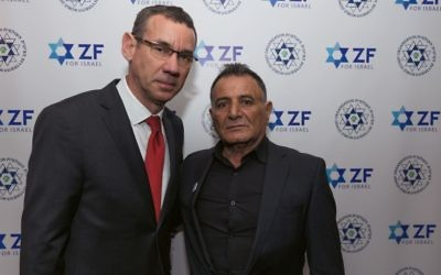 Mark Regev with the father of killed Druze soldier Haiel Sitawe'at the ZF dinner   Credit: Steve Winston