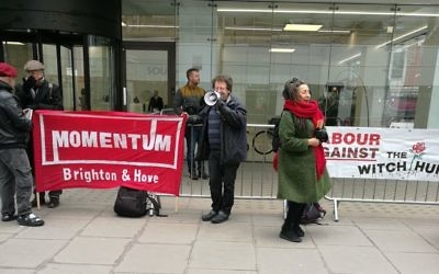 Jackie Walker (right) with Greenstein (left) in front of a Momentum banner