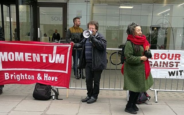 Jackie Walker (right) with Tony Greenstein (left) in front of a Momentum banner outside the Labour Party's HQ