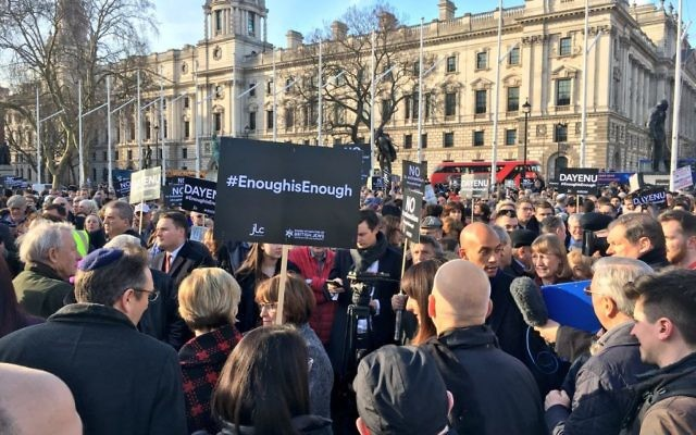 Enough is Enough demonstrators hold up signs against Labour anti-Semitism