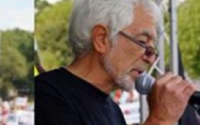 Glyn Secker's Twitter header picture shows him speaking at a pro-Palestine rally