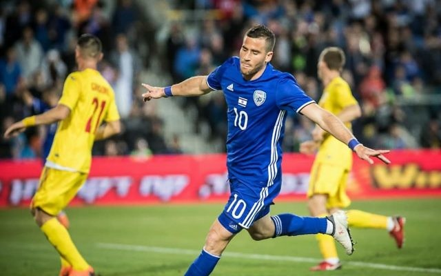 Tomer Hemed celebrates a goal against Romania