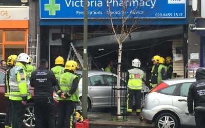 The car having crashed into the front of Victoria Pharmacy