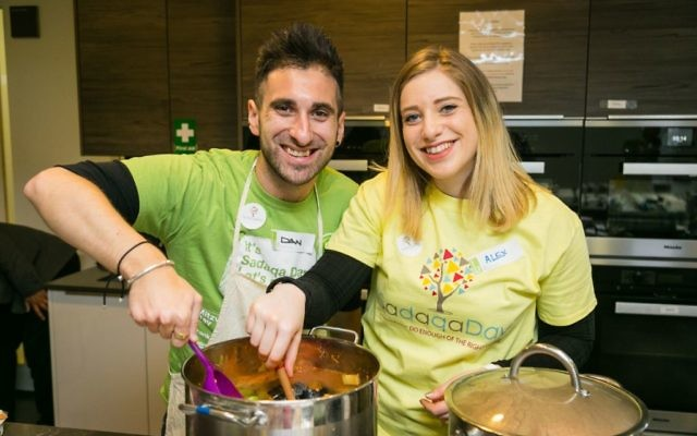 Mitzvah Day Executive Director Dan Rickman and his wife Alexandra Rickman cooking for the Sufra NW at JW3 in March 2018 - picture by Yakir Zur