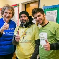 Norwood's Gloria Stoll, Nayim Kadri from Hendon Mosque and Justin Copitch at the Norwood project packing for Sufra NW with JVN - photo by Yakir Zur