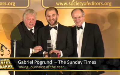 Gabriel Pogrund (centre) accepts his award from From Nick Ferrari (left)