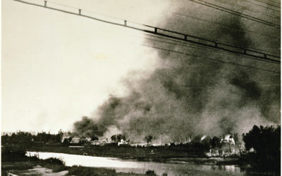 The burning Słonim Ghetto across the Szczara River during the Jewish revolt which erupted in the course of the final Ghetto extermination action, 29 June 1942